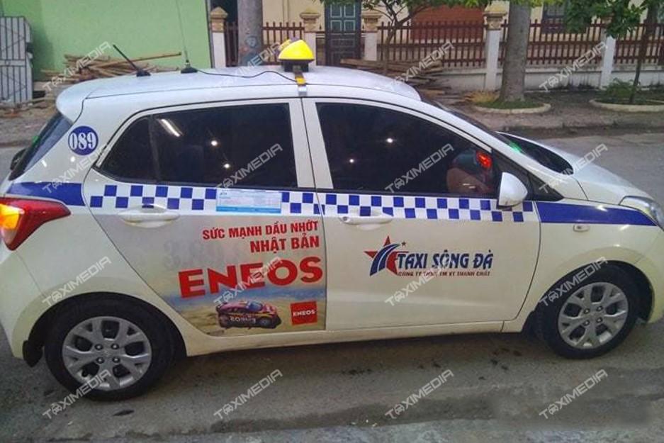 quảng cáo trên xe taxi sông đà