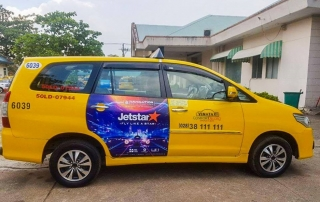 quảng cáo trên taxi Vinataxi