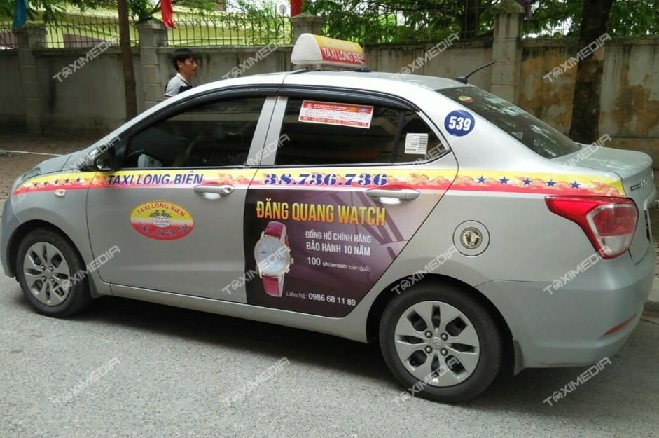 quảng cáo trên xe taxi Long Biên