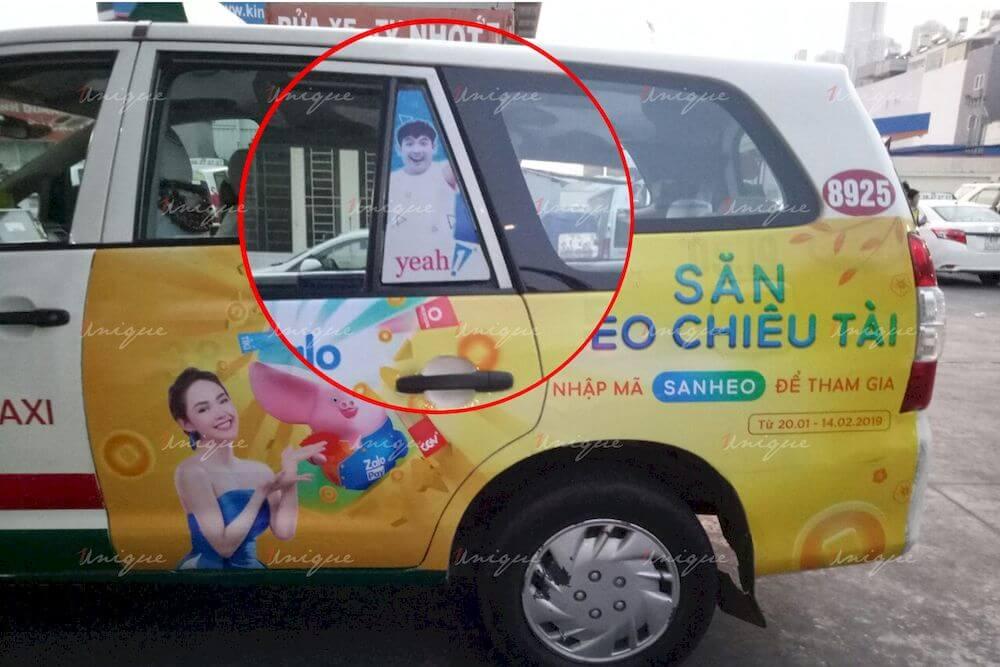 dán quảng cáo trên kính xe taxi